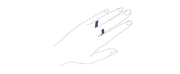 測定したい指の付け根に、紐または紙を巻き付ける
